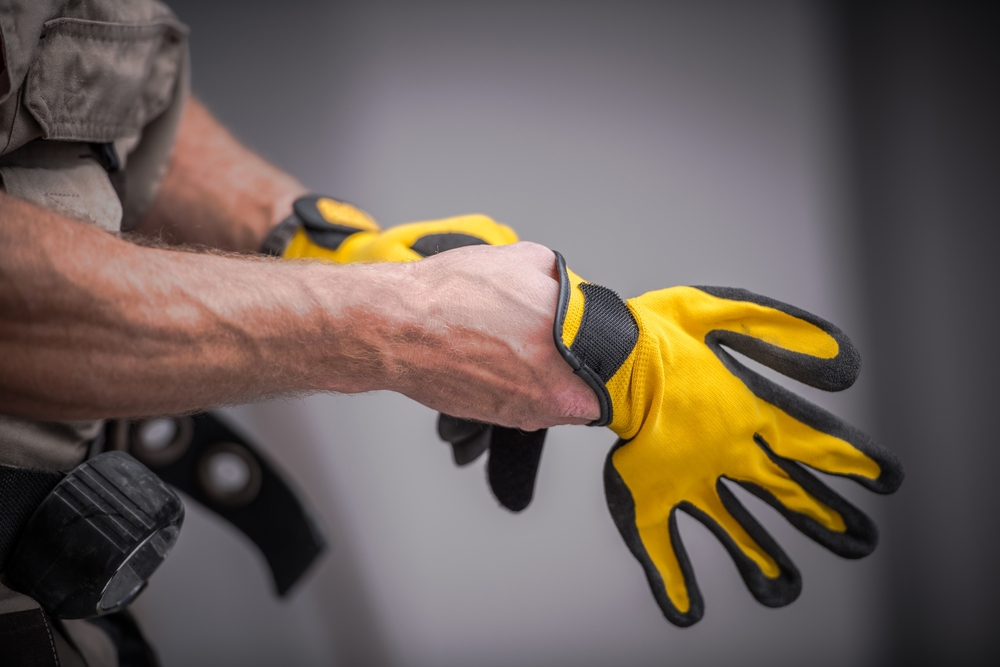 Contractor putting on glove