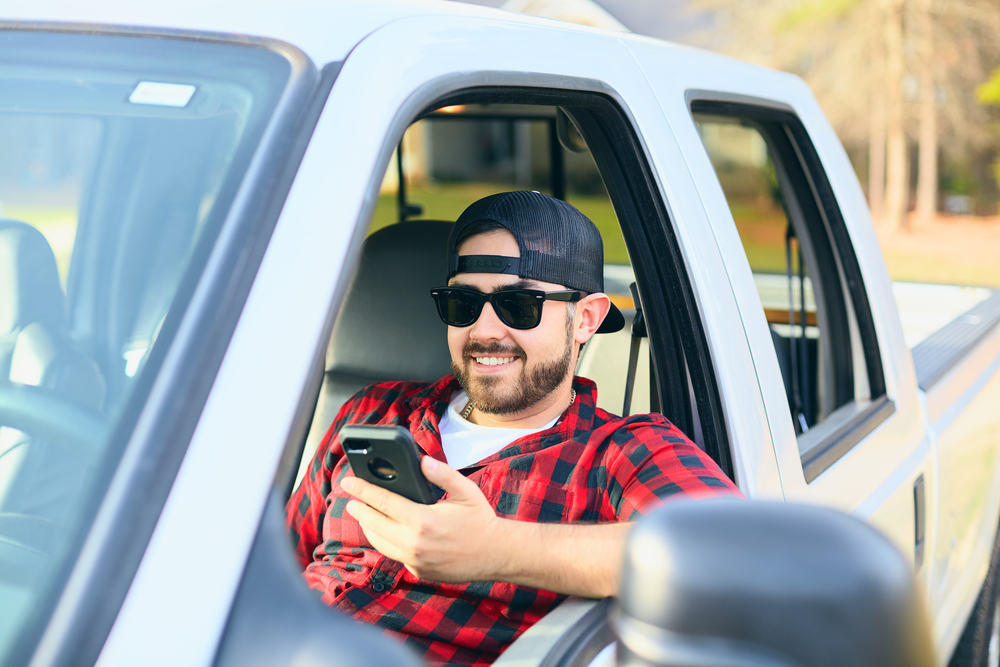 Man on phone in truck