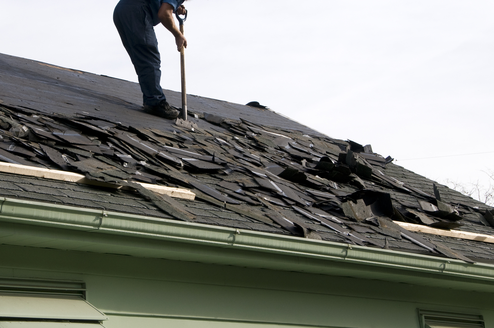 Removing,Old,Shingles,To,Prepare,A,Roof,For,A,New